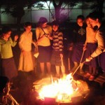 Enjoying the warmth of the Lag BaOmer Bonfire
