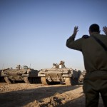 Israeli APCs get instructions before leaving a base in Kissufim, next to the border with the Gaza Strip, southern Israel, 15 November 2012. (Credit: EPA)
